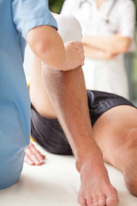 client receiving personal training and hands on care for their injury