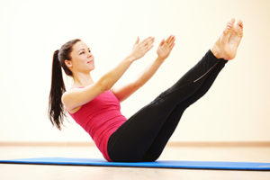 woman performing pilates