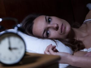 Insomniac woman awake at night
