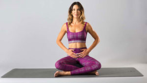 Pelvic floor intro photo of woman sitting on yoga mat