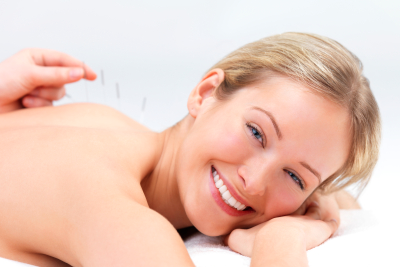 Physiotherapy providing dry needling acupuncture to smiling patient